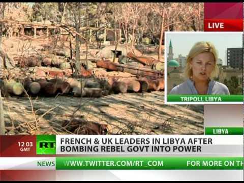 'We'll keep bombing': Cameron & Sarkozy in Libya