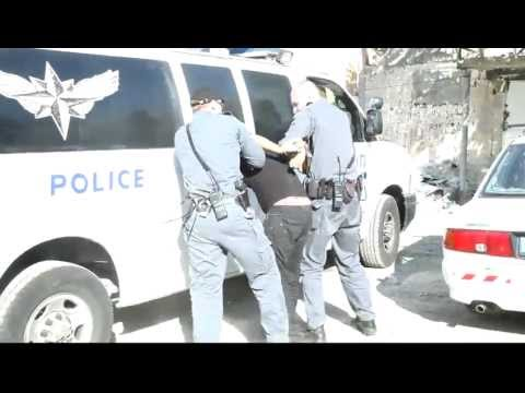 Israeli cop / police brutality during house eviction