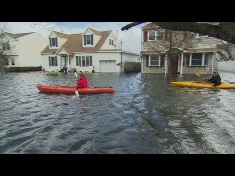 People kayak through New York streets to get home