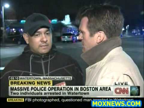 FBI Pulls Suspect Out Of Police Car To Photo Him At Crime Scene