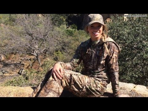Cheerleader's hunting pics spark outrage