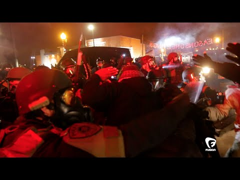 cops outside #Ferguson PD Gas bombed a woman having a heart attack brought to them