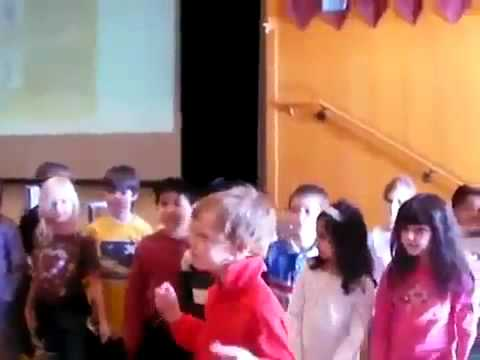 School children sing praises to their savior Obama