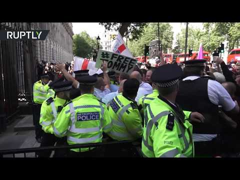Tommy Robinson's supporters clash with police over his imprisonment