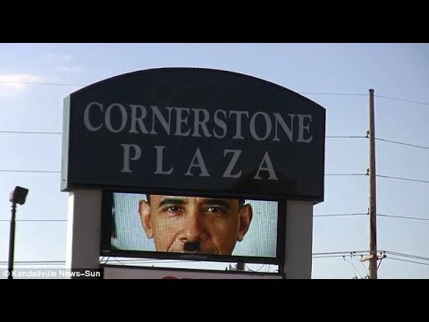 Shopping Center Sign Calls For Obama's Impeachment, Portrays Him As Hitler