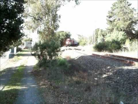 NWP 1922 and RJC 2009 southbound in Petaluma with 9 cars.