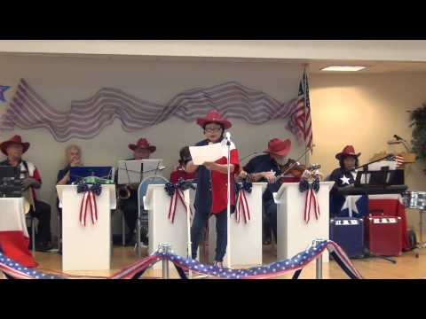 Star Spangled Banner being played and sung at a 4th of July celebration