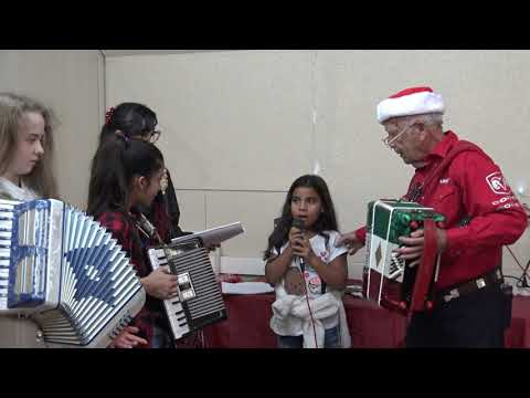 Silent Night being played by the MECATX accordionist