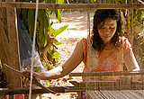 Thai weaver at her loom, weaving an organic cotton scarf
