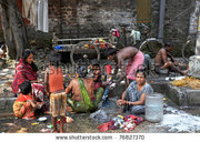 stock-photo-kolkata-india-october-indian-people-wash-themselves-on-a-street-on-october-india-76827370