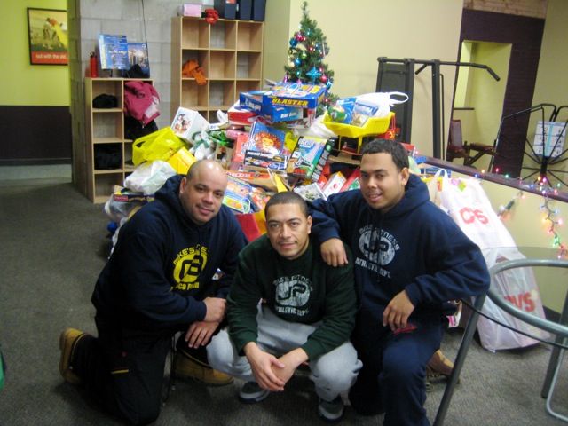 The Fellas at Mikes next to the pile of toys