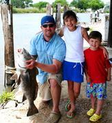 Helping Daddy catch a fish