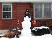 Logan sitting on snowmans head