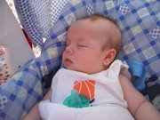 Jason's little brother TY taking a snooze at Jason's game.