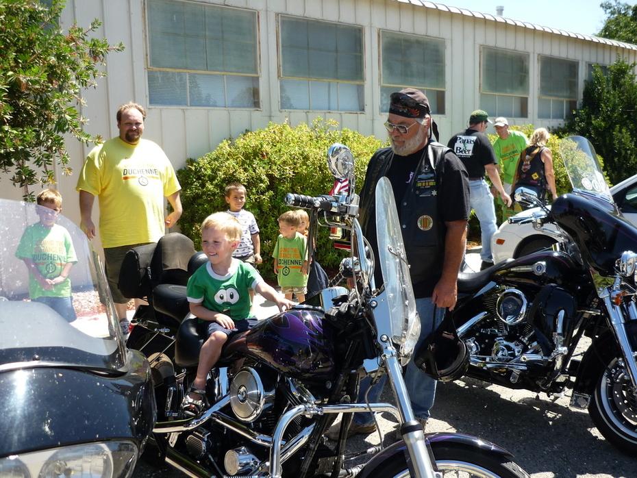 Sitting on a Harley.