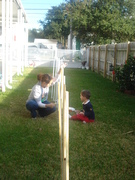 Brogan and Mommy painting lollypop sticks for Christmas decorations
