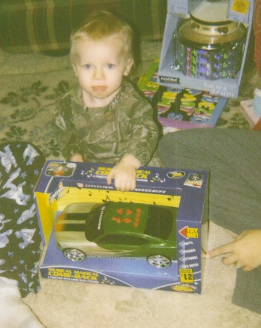 Jacob opening up his toy car, he loves that thing