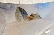 Reflection in a little bit of water in the street ..(Charlie Point,Berlin)