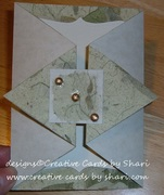 green and beige trifold