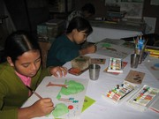 Numali and Deepa  finishing their art at Parijat