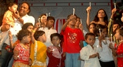 rahul with kids & candles for peace