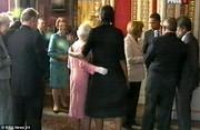 Michelle teaches the Queen hug protocol