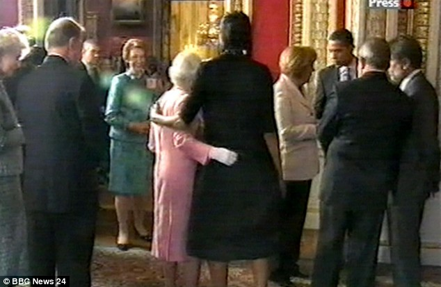 Michelle teaches the Queen hug protocol