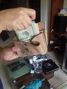 Monedero en uso