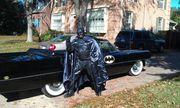 Sam Jackson in front of Cadillac Batmobile
