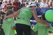 Cal and sister Emily with mom crossing the triathlon finish line!