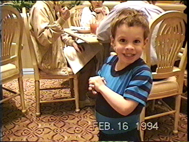 Anthony waits anxiously to see Mickey Mouse in 1994
