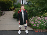 Anthony standing in his KAFOs at first day of school 2006