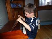 Evan playing piano