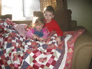 Cute Grandkids under one of my quilts!