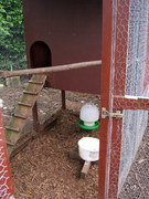 feeder and water bowl inside