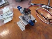 Fuel flow sensor on bracket.