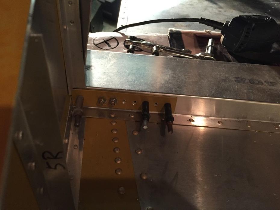 Strut bracket reinforcement plates