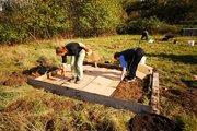 Adding cardboard for mulching in the future herb garden