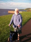 Mom enjoying the Scottish sunshine beside the Tay Estuary
