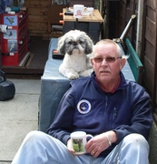 one man and his cup and dog