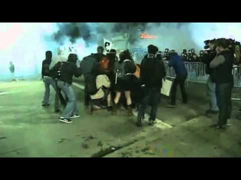 Oakland Policeman Throws Flash Grenade Into Crowd Trying To Help Injured Protester