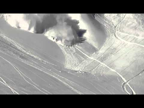Skier does backflip while being chased by avalanche
