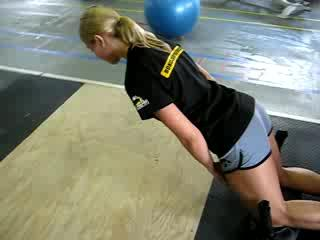 College volleyball training program glute ham raise