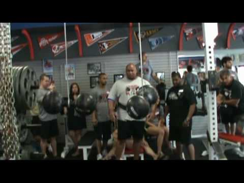 Rich Williams presses two Thomas Inch dumbbells overhead