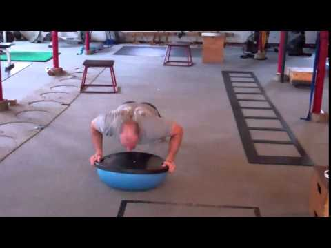 How to perform a power push-up on a Bosu Ball