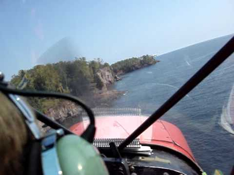 FLYING IN A PIPER CUB ON NORTH SHORE  BY SPLIT ROCK LIGHT HOUSE. CUB FLY IN DAY.