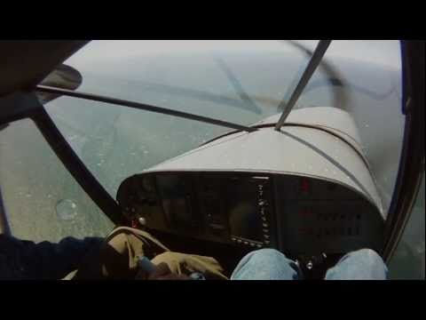Off-airport STOL landing and take-off on bluff overlooking the Pacific Ocean