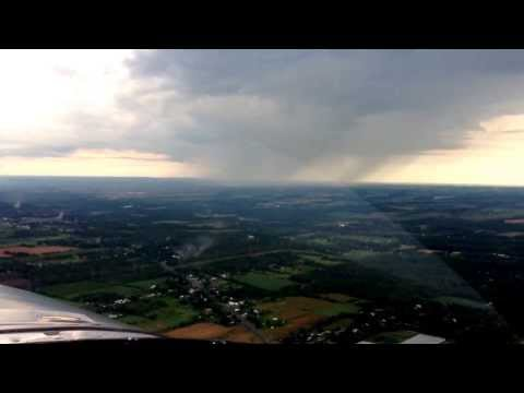 C-GYXQ Enroute back to CYOO from Boots and Hearts concert. Rain shaft north of the field.