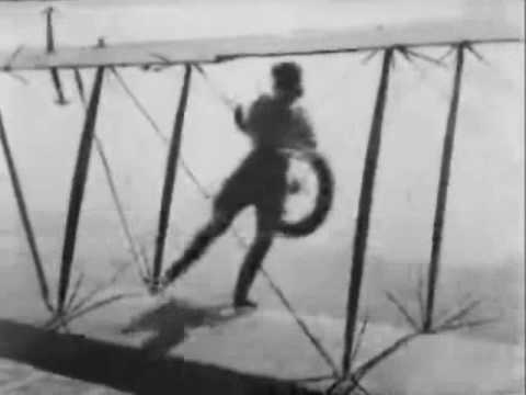 Gladys Ingle of the 13 BLACK CATS changes planes in mid-air
