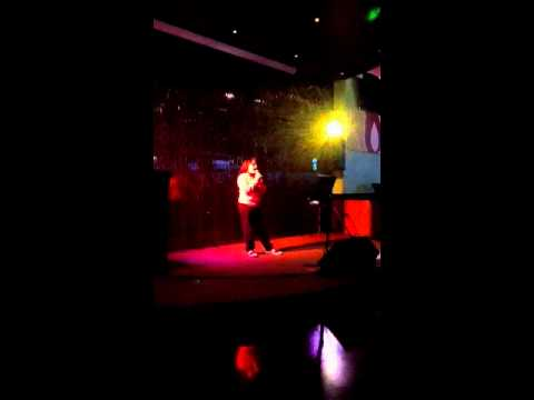 Zoe Alexa singing at skylight